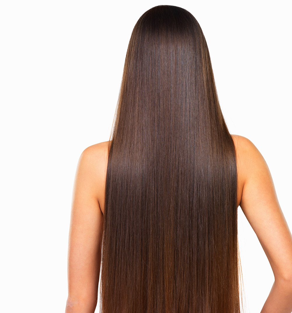 Rear view of woman with long hair over white background